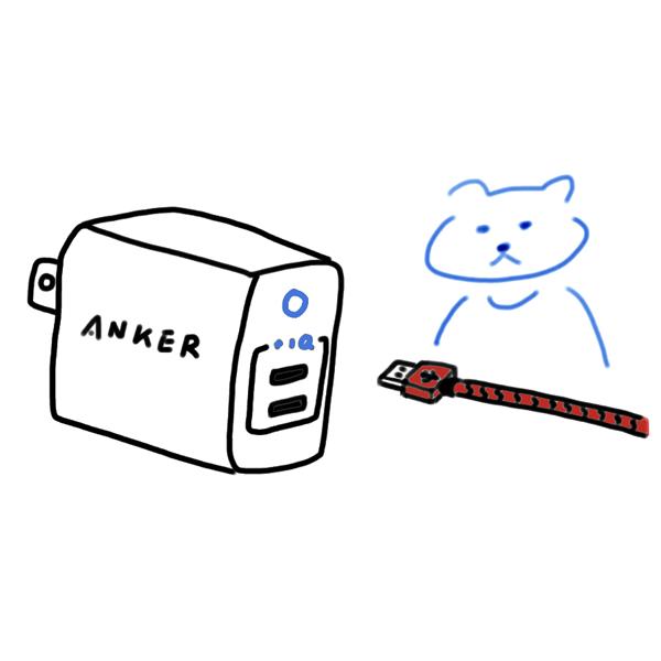 USB充電器とUSB充電ケーブルを見る猫のイラスト